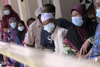 Voters wearing face masks wait for their turn at a polling station during a state election on the outskirts of Kota Kinabalu, in Malaysia's Sabah state on Borneo island, on Sept. 26, 2020. (AP Photo)