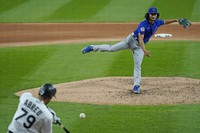 Chicago Cubs starting pitcher Yu Darvish, of Japan, throws the ball to Chicago White Sox's Jose Abreu during the fourth inning of a baseball game in Chicago, on Sept. 25, 2020. (AP Photo/Nam Y. Huh)