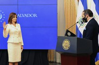 In this In this photo released by the El Salvador Presidential Press Office, Salvadoran President Nayib Bukele swears in Milena Mayorga as the country's next ambassador to the U.S., at Government House, in San Salvador, El Salvador, Thursday, Sept. 24, 2020. (El Salvador Presidential Press Office via AP)