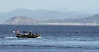 A South Korean marine boat patrols near Yeonpyeong island, South Korea, Sunday, Sept. 27, 2020. (Baek Seung-ryul/Yonhap via AP)