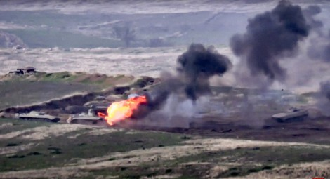 In this image taken from a footage released by Armenian Defense Ministry on Sunday, Sept. 27, 2020, Armenian forces destroy Azerbaijani military vehicle at the contact line of the self-proclaimed Republic of Nagorno-Karabakh, Azerbaijan. (Armenian Defense Ministry via AP)