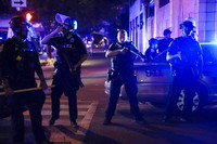 Police stand guard on the perimeter of a crime scene after a police officer was shot, on Sept. 23, 2020, in Louisville, Ky. (AP Photo/John Minchillo)