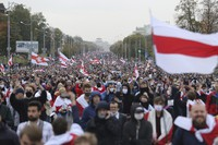 People with old Belarusian national flags march during an opposition rally to protest the official presidential election results in Minsk, Belarus, on Sept. 27, 2020. (AP Photo/TUT.by)