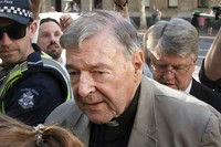 In this Feb. 27, 2019, file photo, Cardinal George Pell arrives at the County Court in Melbourne, Australia. (AP Photo/Andy Brownbill)