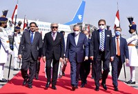 In this picture provided by Pakistan's Ministry of Foreign Affairs, Abdullah Abdullah, chairman of Afghanistan's High Council for National Reconciliation, second left, is accompanied by Pakistani officials upon his arrival at Nur Khan airbase in Rawalpindi, Pakistan, on Sept. 28, 2020. (Ministry of Foreign Affairs via AP)