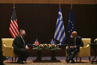 U.S. Secretary of State Mike Pompeo, left, and Greek Foreign Minister Nikos Dendias speak during their meeting in the northern city of Thessaloniki, Greece, on Sept. 28, 2020. (AP Photo/Giannis Papanikos)