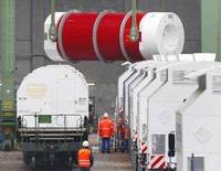 In this Monday, Nov. 8, 2010 file photo, a container with nuclear waste is loaded from a train onto a a truck in Dannenberg, near Gorleben, northern Germany.(AP Photo/Michael Probst)