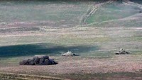 In this image taken from a footage released by Armenian Defense Ministry on Sept. 27, 2020, Armenian army destroys Azerbaijani tanks at the contact line of the self-proclaimed Republic of Nagorno-Karabakh, Azerbaijan. (Armenian Defense Ministry via AP)