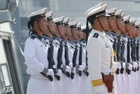 In this Jan. 17, 2019, file photo, Chinese People's Liberation Navy sailors stand in formation on the deck of a type 054A guided missile frigate