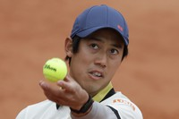 Japan's Kei Nishikori serves against Britain's Daniel Evans in the first round match of the French Open tennis tournament at the Roland Garros stadium in Paris, France, on Sept. 27, 2020. (AP Photo/Alessandra Tarantino)
