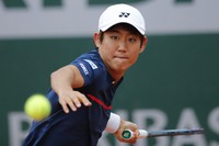 Japan's Yoshihito Nishioka plays a shot against Canada's Felix Auger-Aliassime in the first round match of the French Open tennis tournament at the Roland Garros stadium in Paris, France, on Sept. 28, 2020. (AP Photo/Christophe Ena)