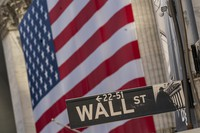 The Wall Street sign is framed by a giant American flag hanging on the New York Stock Exchange, on Sept. 21, 2020. (AP Photo/Mary Altaffer)