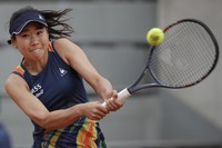 Japan's Nao Hibino plays a shot against Ukraine's Marta Kostyuk in the first round match of the French Open tennis tournament at the Roland Garros stadium in Paris, France, on Sept. 29, 2020. (AP Photo/Alessandra Tarantino)