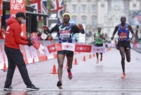 Ethiopia's Shura Kitata crosses the line to win the London Marathon in London, England, on Oct. 4, 2020. (Richard Heathcote/Pool via AP)