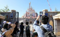 Visitors are seen taking photos in front of the new attraction