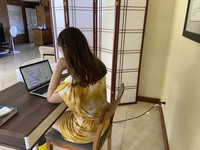 This photo provided by Adrienne Robillard shows her daughter, name withheld by parent, doing school work at a computer at home in Kailua, Hawaii, on Sept. 18, 2020. (Adrienne Robillard via AP)