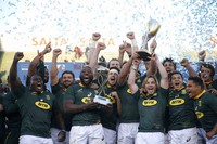 In this Aug. 10, 2019, file photo, South Africa teammates celebrate at the end of a rugby championship match against Argentina in Salta, Argentina. (AP Photo/Florencia Tanjun)