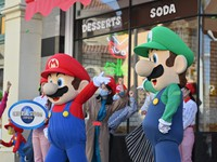 Mascots of Mario, left, and Luigi, characters appearing in Nintendo Co.'s