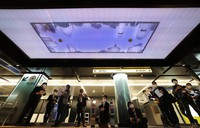 Pillars near the ticket gates to Tokyo Metro Hibiya Line are illuminated silver white at Ginza Station in Tokyo's Chuo Ward on Oct. 16, 2020. A picture on the ceiling shows the cityscape above. (Mainichi/Shinnosuke Kyan)