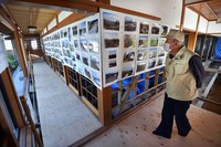 This Oct. 12, 2020 photo shows an exhibition at Myoshoji temple in the central Japan city of Nagano where pictures on display reveal the different stages in the transition from the collapse of the levee of the Chikuma River to its restoration. (Mainichi/Daiki Takikawa)