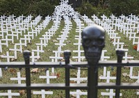 Toby Gregory's yard that is adorned with 1,006 white crosses to represent Oklahoma deaths due to COVID-19, on Oct. 14, 2020, in Tulsa, Okla. (Mike Simons/Tulsa World via AP)