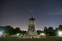 The moon and street lights illuminate the statue of Confederate General Robert E. Lee on Monument Avenue on June. 5, 2020, in Richmond, Va. (AP Photo/Steve Helber)