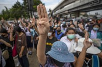 Pro-democracy activists flash three-fingered salute during a demonstration at Kaset intersection, suburbs of Bangkok, Thailand, on Oct. 19, 2020. (AP Photo/Sakchai Lalit)