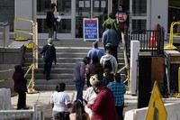 Residents line up outside the voter services office on Oct. 19, 2020, in Norristown, Pennsylvania. (AP Photo/Matt Slocum)