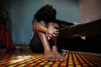 A teenage girl who became a sex worker after schools in Kenya were closed in March due to coronavirus restrictions, sits in the rented room where she and others work, in Nairobi, Kenya, on Oct. 1, 2020. (AP Photo/Brian Inganga)