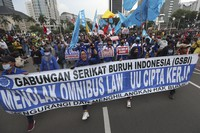 Protesters shout slogans during a march protesting against the new jobs law in Jakarta, Indonesia, on Oct. 20, 2020. (AP Photo/Achmad Ibrahim)