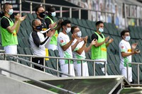 In this May 31, 2020 file photo Moenchengladbach alternate players wearing face masks applaud during the German Bundesliga soccer match between Borussia Moenchengladbach and Union Berlin in Moenchengladbach, Germany. (AP Photo/Martin Meissner)