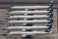 In this March 6, 2020, file photo, Cathay Pacific Airways aircrafts line up on the tarmac at the Hong Kong International Airport. (AP Photo/Kin Cheung)