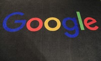 In this Nov. 18, 2019 file photo, the logo of Google is displayed on a carpet at the entrance hall of Google France in Paris. (AP Photo/Michel Euler)