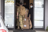 Military personnel enter the Sudima Hotel in Christchurch, New Zealand, Tuesday, Oct. 20, 2020. (AP Photo/Mark Baker)