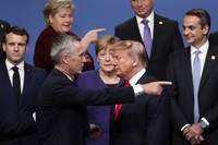 In this Dec. 4, 2019 file photo, NATO Secretary General Jens Stoltenberg, front left, speaks with U.S. President Donald Trump, front right, after a group photo at a NATO leaders meeting at The Grove hotel and resort in Watford, Hertfordshire, U.K. (AP Photo/Francisco Seco)