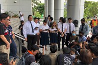 University students read a statement about a motion they lodged with the court outside Bangkok Civil Court in Bangkok, Thailand, on Oct. 21, 2020. (AP Photo/Jerry Harmer)