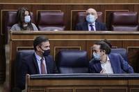 Spanish Prime Minister Pedro Sanchez, left and 2nd deputy Prime Minister Pablo Iglesias talk during a parliamentary session in Madrid, Spain, on Oct. 21, 2020. (AP Photo/Manu Fernandez, Pool)