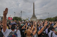 Pro-democracy activists flash three-fingered salute during a demonstration at Victory Monument in Bangkok, Thailand, on Oct. 21, 2020. (AP Photo/Sakchai Lalit)