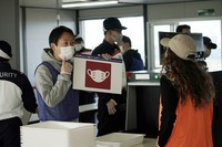 Staffs and security personnel participate in a screening test for spectators and officials to ensure a safe and secure Toyo Olympic Games on Oct. 21, 2020, in Tokyo. (AP Photo/Eugene Hoshiko)