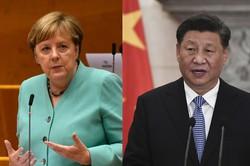 メルケル独首相(左)は中国の習近平国家主席を批判した(Bloomberg)