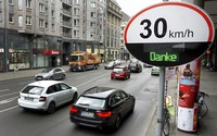 In this May 20, 2019 file photo, cars pas by a speed limit traffic sign at the 'Leipziger Strasse' in Berlin, Germany. (AP Photo/Michael Sohn)