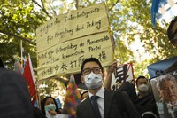 This file picture taken Sept.1, 2020 shows Hong Kong activist Nathan Law, center, taking part in a protest during the visit of Chinese Foreign Minister Wang Yi in Berlin, Germany, (AP Photo/Markus Schreiber,file)