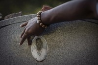 A portrait of James Chaney is seen on the headstone of his grave in Meridian, Miss., Saturday, Oct. 3, 2020. Chaney was one of three civil rights activists that was kidnapped by a deputy sheriff and local Klansmen, and driven to a narrow country road and shot at close range. (AP Photo/Wong Maye-E)