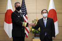Adm. Philip Davidson, left, commander of the U.S. Indo-Pacific Command, poses with Japan's Prime Minister Yoshihide Suga for a photo during his courtesy call at the prime minister's office on Oct. 22, 2020, in Tokyo. (AP Photo/Eugene Hoshiko, Pool)