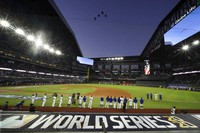 The Los Angeles Dodgers line up during during the national anthem and a fly over before Game 1 of the baseball World Series against the Tampa Bay Rays on Oct. 20, 2020, in Arlington, Texas. (AP Photo/Eric Gay)