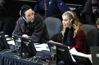 Announcers Johnny Weir and Tara Lipinski talk during the women's free skate program at the U.S. Figure Skating Championships in Detroit. (AP Photo/Paul Sancya)