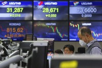 A currency trader watches monitors at the foreign exchange dealing room of the KEB Hana Bank headquarters in Seoul, South Korea, on Oct. 23, 2020. (AP Photo/Ahn Young-joon)