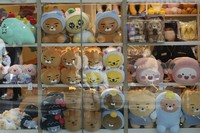An employee wearing a face mask arranges dolls at a shop in Seoul, South Korea, on Oct. 22, 2020. (AP Photo/Ahn Young-joon)