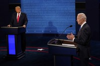 Democratic presidential candidate former Vice President Joe Biden answers a question as President Donald Trump listens during the second and final presidential debate on Oct. 22, 2020, at Belmont University in Nashville, Tenn. (AP Photo/Morry Gash, Pool)