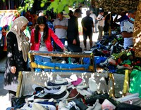 People shop for clothing at the used-clothes market in Baghdad, Iraq, on Oct. 20, 2020.  (AP Photo/Khalid Mohammed)